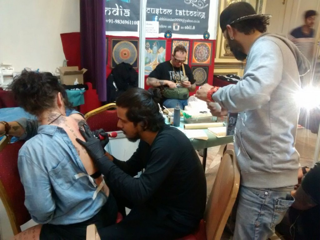 (From Left) Laila getting tattooed by Rishabh at Kevin Andrade's (standing) booth.