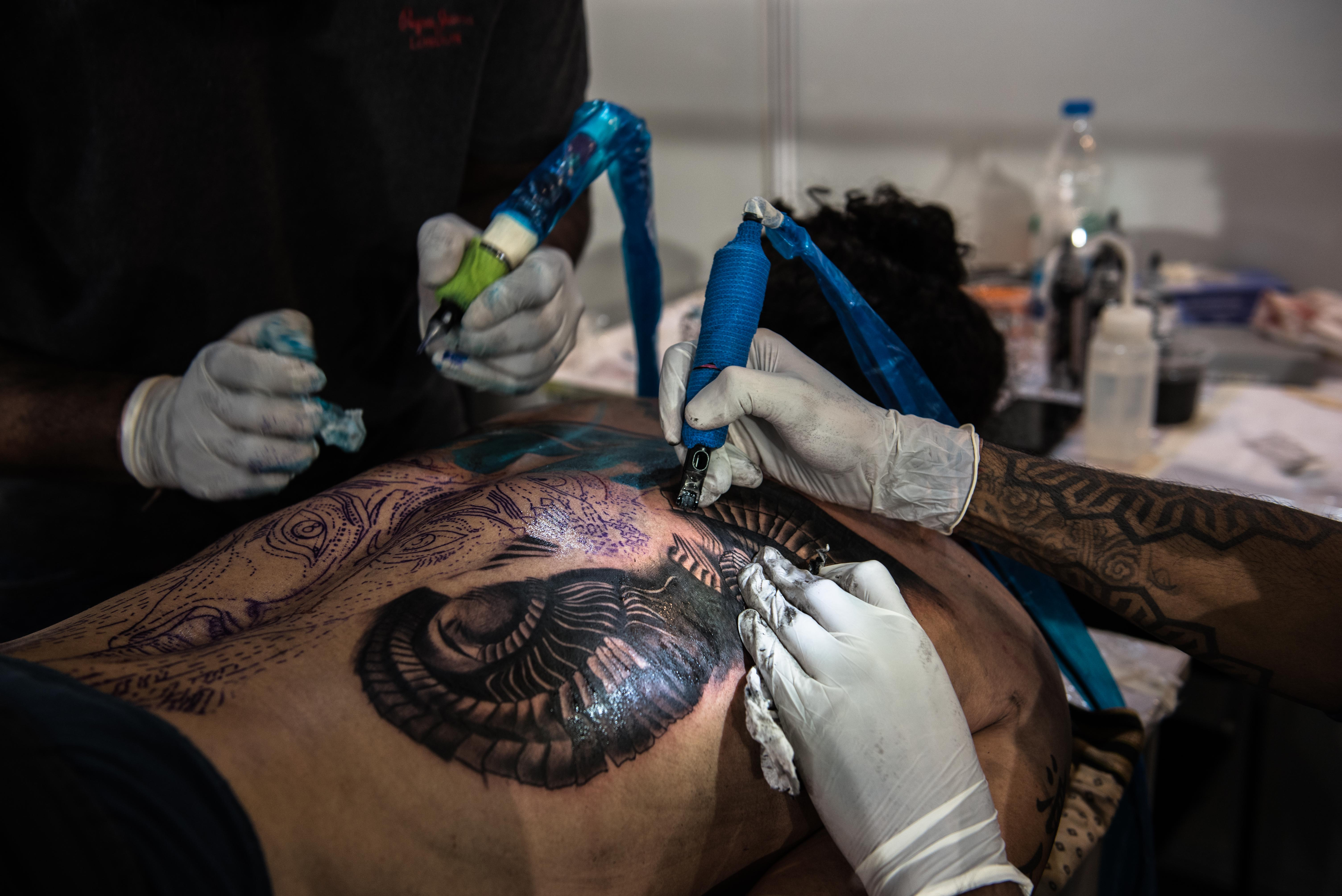 Mangesh Rane and Amit Spyd of Sabby's Tattoo Studio, Pune working on a collab. All images © S Chak